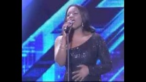 Irene Logan performs at the GLO X Factor Results Show